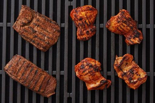 Cook the steaks & chicken