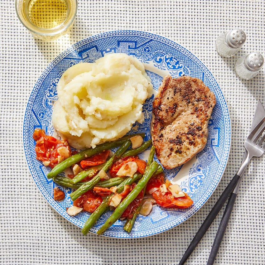 Tuscan-Spiced Pork & Mashed Potatoes with Green Beans & Roasted Tomato Dressing