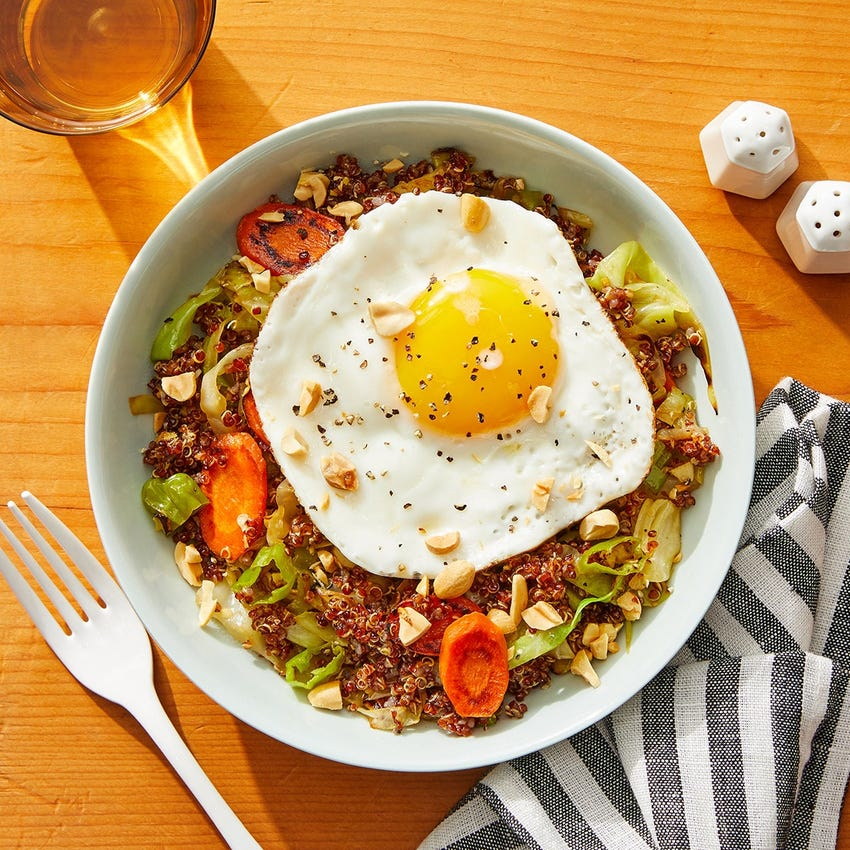 "Quinoa & Vegetable ""Fried Rice"" with Sunny Side-Up Eggs & Peanuts"