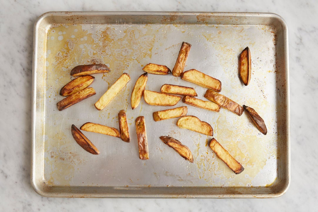 Prepare the potatoes & make the oven fries:
