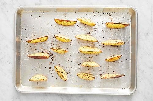 Roast the potatoes: