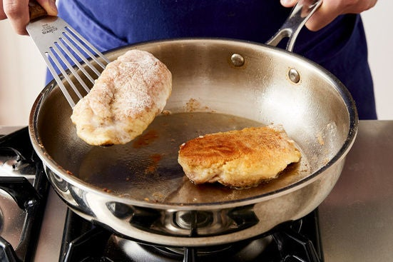 Coat & cook the chicken: