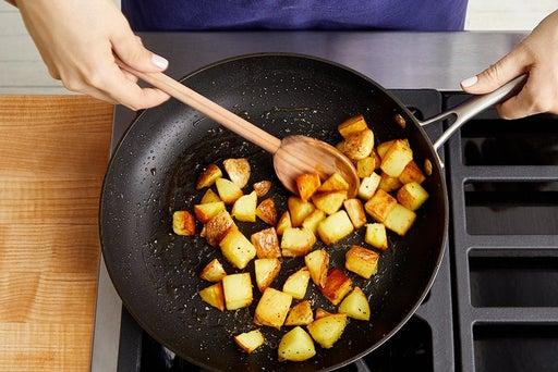 Crisp the potatoes & finish the vegetables: