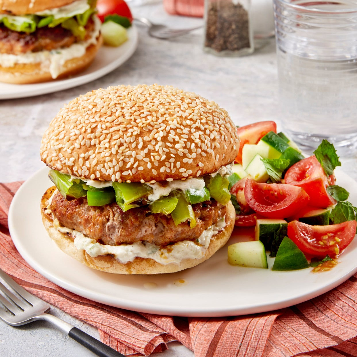 Pork Burgers & Blistered Shishito Peppers with Cucumber & Heritage Globe Tomato Salad