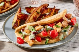 Chicken Souvlaki Pitas with Heirloom Tomato & Garlic-Oregano Potatoes