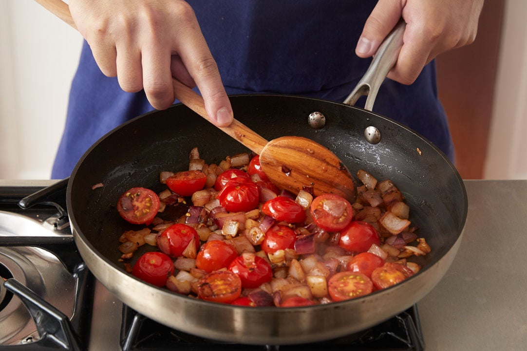 Cook the onion & tomatoes: