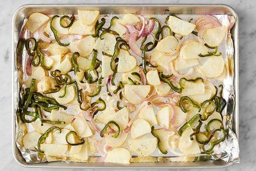 Roast the potatoes, onion & poblano peppers: