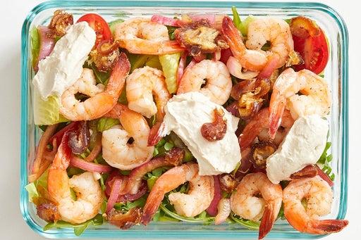 Finish & serve the Seared Shrimp Salad