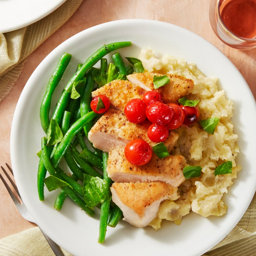 Seared Chicken & Blistered Cherry Tomatoes with Garlic Mashed Potatoes