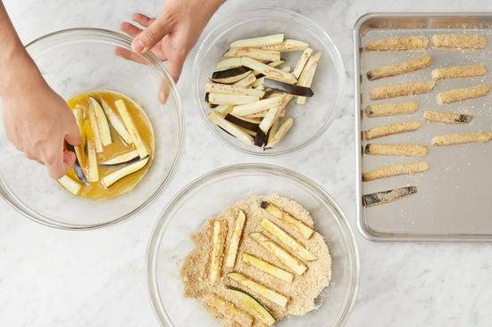 Bread the eggplant fries: