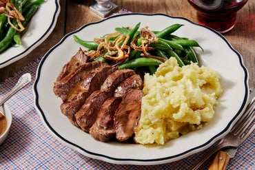 Seared Steaks & Thyme Pan Sauce with Mashed Potatoes, Green Beans, & Crispy Shallot