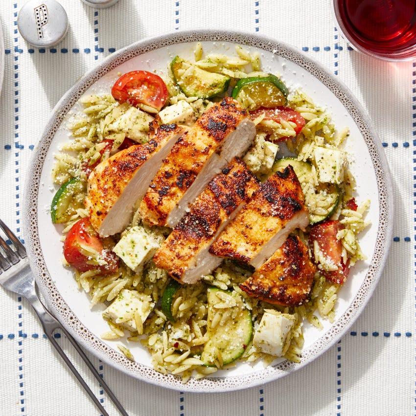 Seared Chicken over Orzo Pasta with Tomatoes,  Zucchini & Basil Pesto