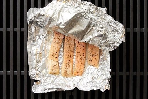 Make the foil packet & grill the fish: