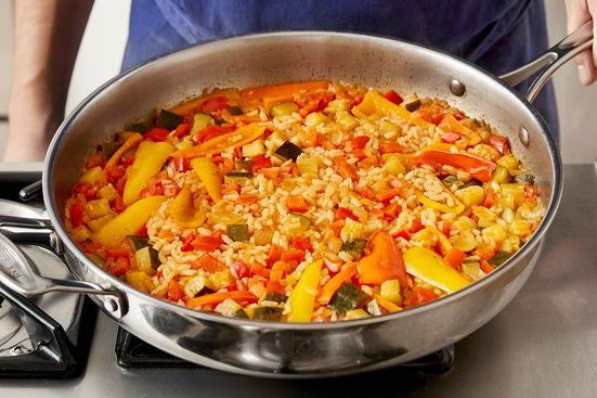 Cook the rice & finish the paella: