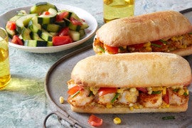 Cornmeal-Crusted Shrimp Po' Boys with Tomato & Cucumber Salad