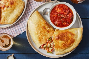 Fontina & Ricotta Calzones with Sweet Peppers, Tomatoes, & Basil