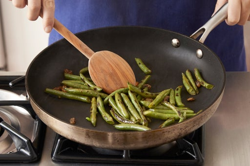 Char the green beans & finish the rice: