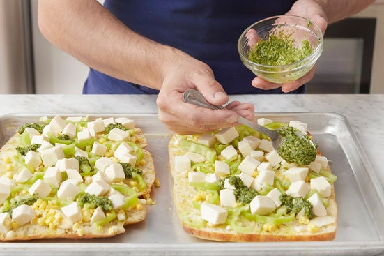 Assemble the pizzas: