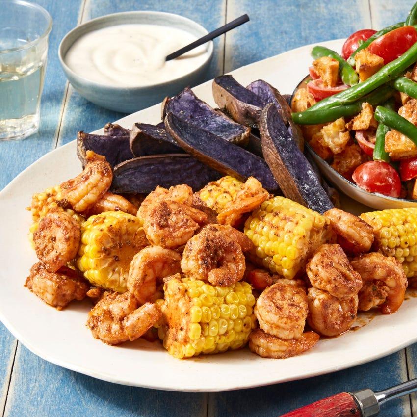 Garlic-Butter Shrimp & Corn with Green Bean Salad & Roasted Purple Potatoes