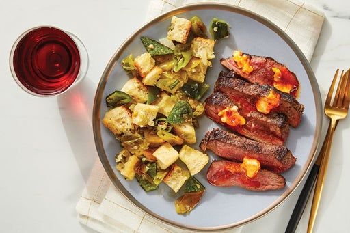Calabrian Chile Butter Steaks with Roasted Pepper Panzanella