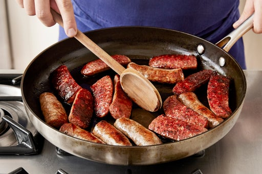 Brown the sausages: