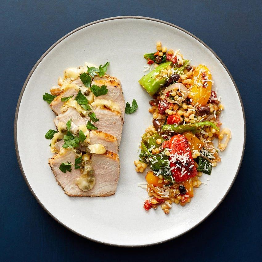 Fontina & Caper-Stuffed Pork Roast with Fregola Sarda, Peppers & Spinach