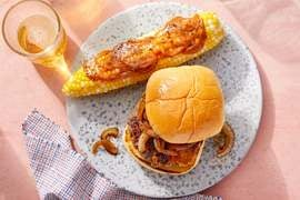 Caramelized Onion & Gouda Burgers with Creamy Mustard-Dressed Corn on the Cob