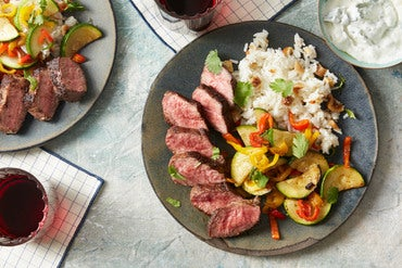 Spice-Rubbed Steaks & Basmati Rice with Summer Squash, Figs, & Garlic Labneh Sauce