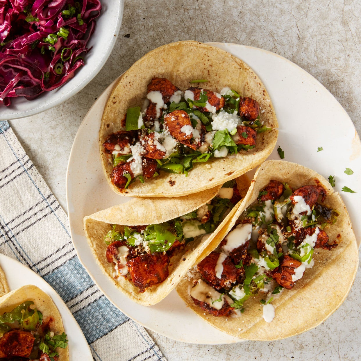 Ancho Chile Chicken Tacos with Blistered Shishito Peppers & Cabbage Slaw