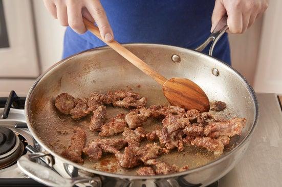 Coat & cook the beef: