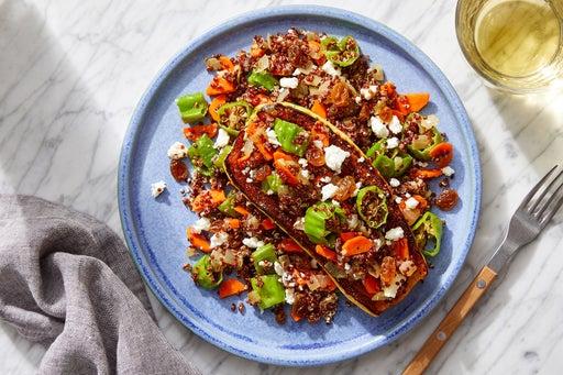 Stuffed Delicata Squash with Quinoa, Carrots & Pickled Raisins