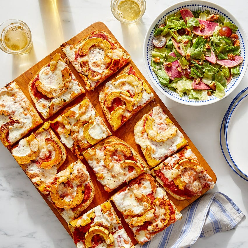 Fontina & Delicata Focaccia Pizza with Watermelon Radish, Grape & Walnut Salad