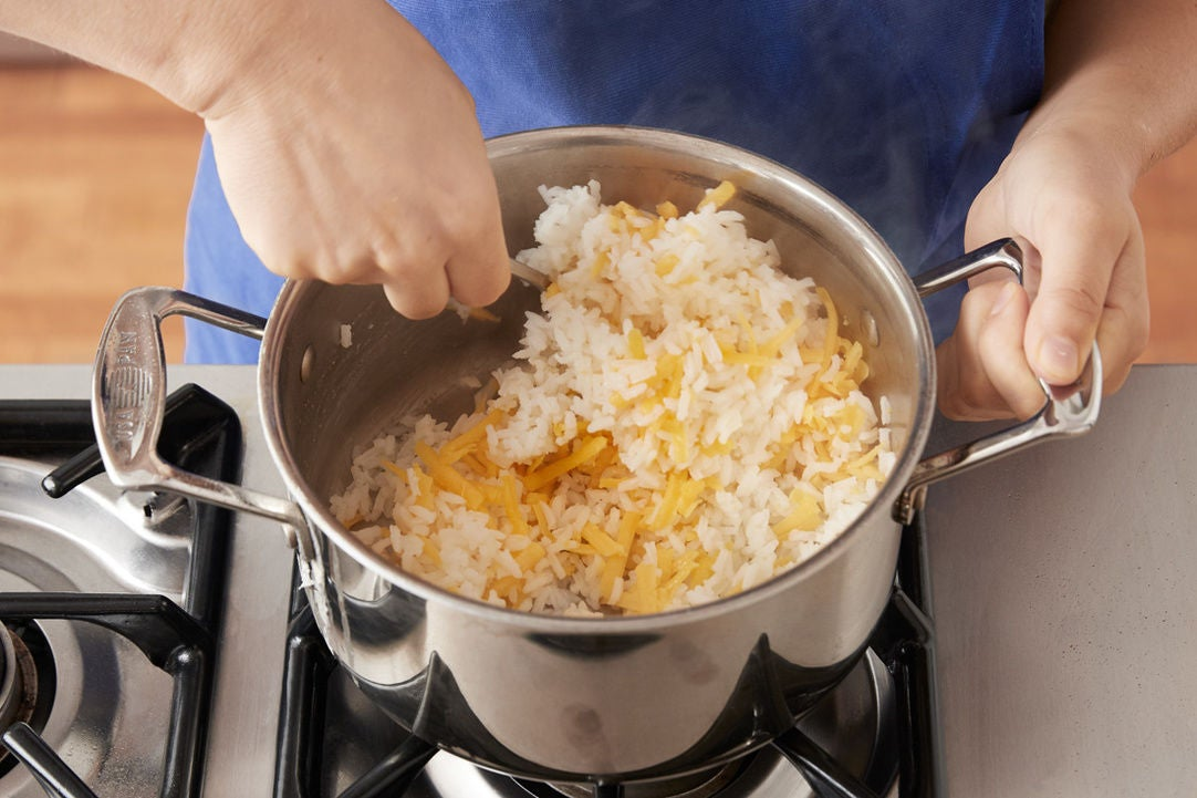 Make the cheesy rice: