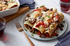 Spicy Black Bean & Kale Enchiladas with Cheddar Cheese