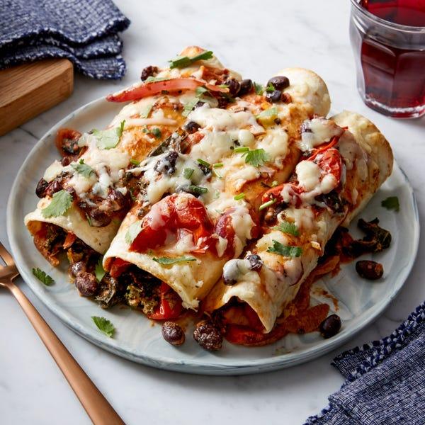 Spicy Black Bean & Kale Enchiladas with Cheddar Cheese