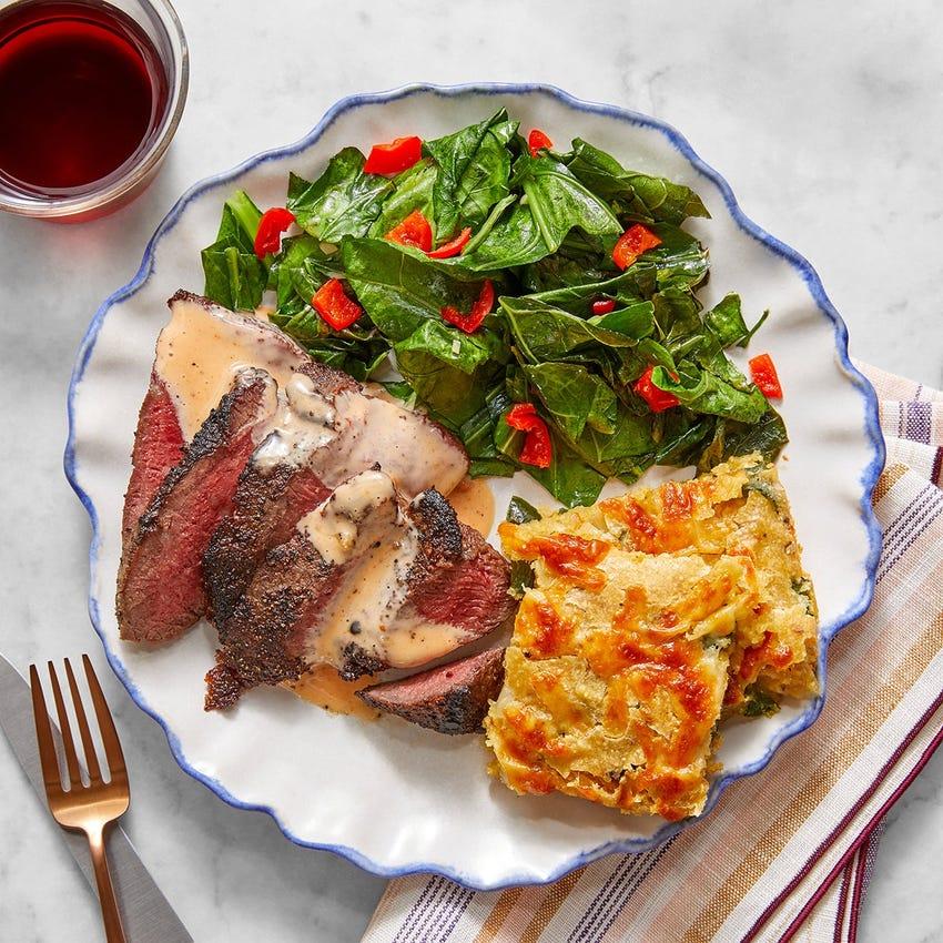 Seared Steaks & Cheddar Spoonbread with Braised Collard Greens