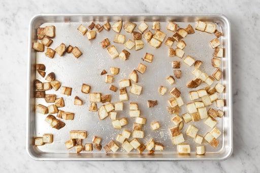 Prepare & roast the potatoes: