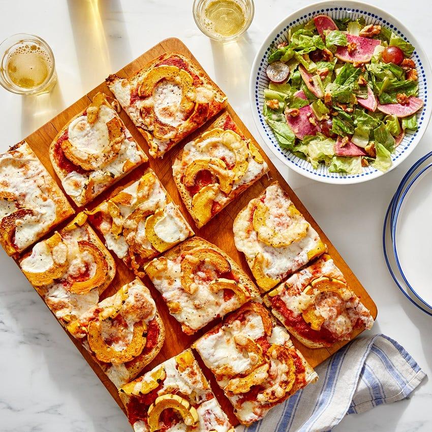 Fontina & Delicata Focaccia Pizza with Watermelon Radish, Grape & Walnut Salad