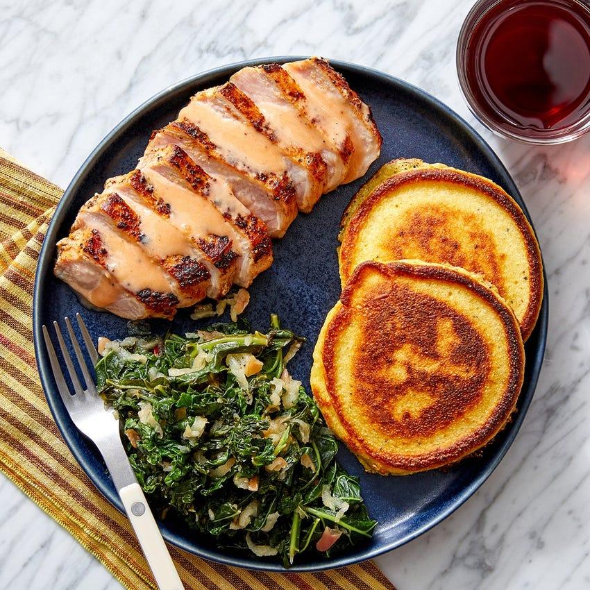 Southern Pork Chops & Crispy Corn Cakes with Braised Apple & Kale