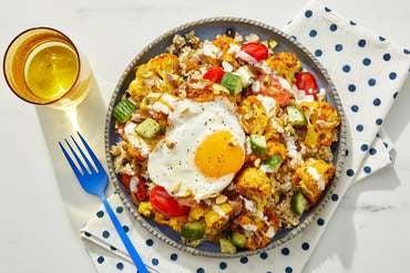Shawarma Cauliflower Grain Bowls with Cucumber-Tomato Salad & Fried Eggs