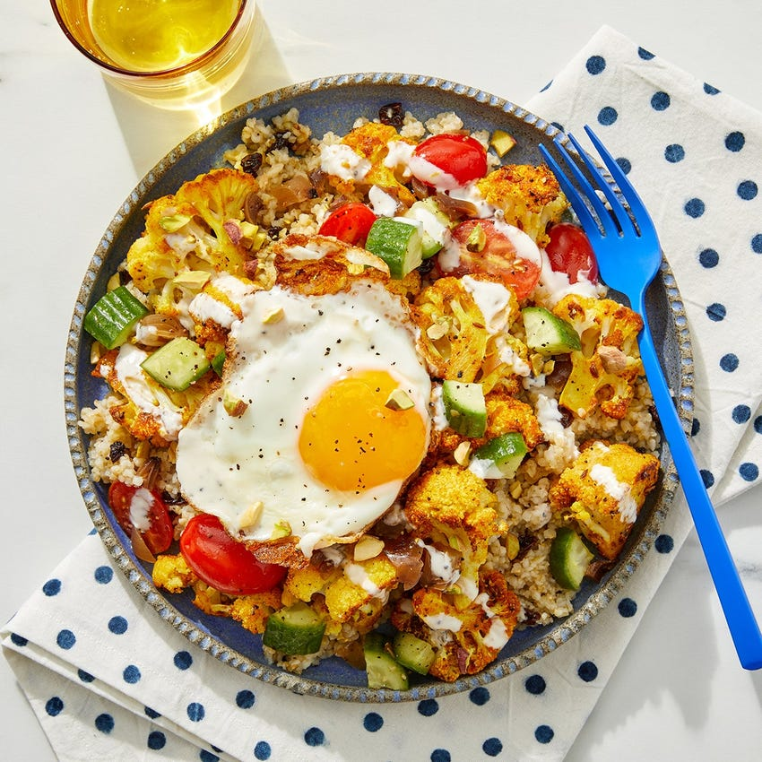 Shawarma Cauliflower Grain Bowls with Cucumber-Tomato Salad & Fried Eggs
