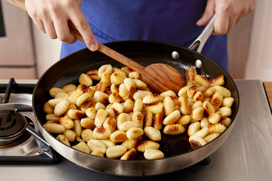 Crisp the gnocchi & serve your dish: