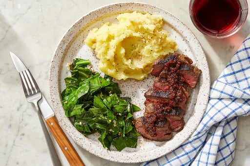 Steaks & Tomato Chutney Pan Sauce with Mashed Potatoes & Collard Greens