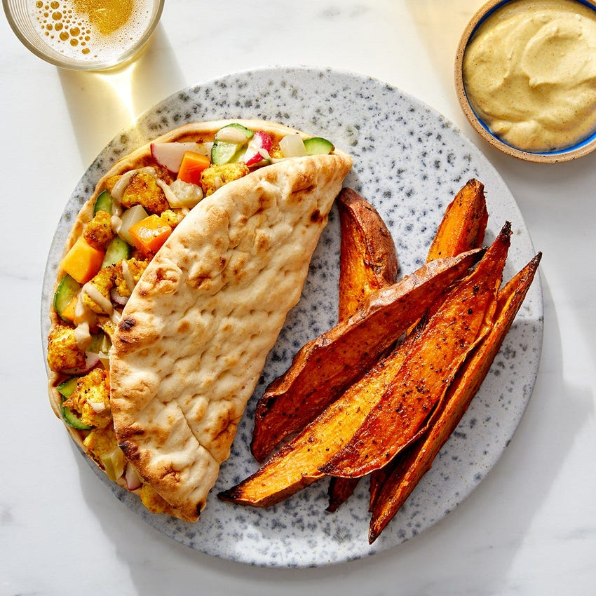 Shawarma-Style Tofu & Vegetable Pitas with Sweet Potato Wedges & Spiced Sour Cream