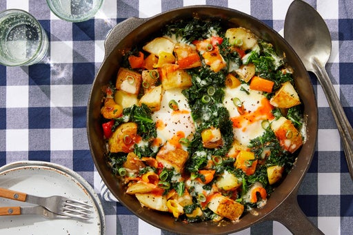 Potato & Kale Hash with Baked Eggs & Hot Sauce