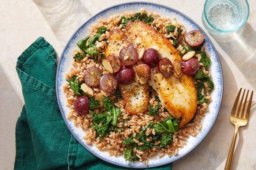 Tilapia & Brown Butter-Grape Pan Sauce with Farro & Kale