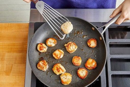 Cook & halve the scallops