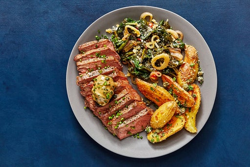 NY Strip Steaks & Truffle Butter with Fingerling Potatoes & Sautéed Spinach