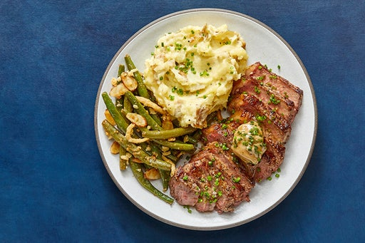 NY Strip Steaks & Truffle Butter with Cheddar Mashed Potatoes & Sautéed Green Beans