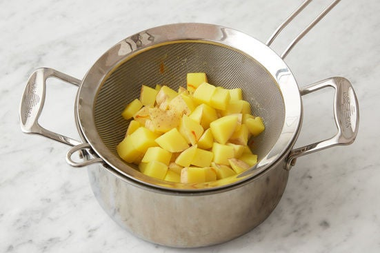 Prepare & cook the potatoes: